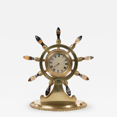 English gilt metal clock in the form of a ships wheel
