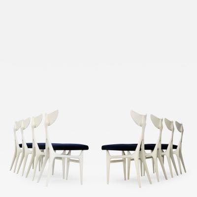 Ennio Canino Set of eight chairs MidCentury by Ennio Canino in white and blue Published 1954