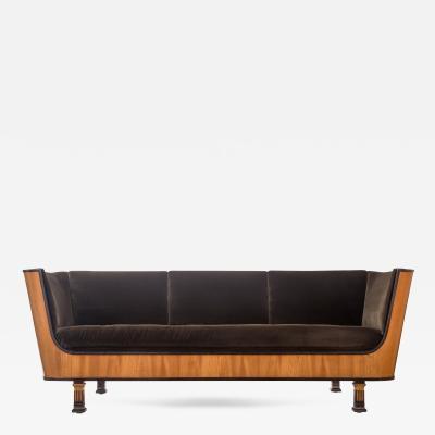 Erik Chambert A Swedish Ebonized and Elm Day Bed Sofa
