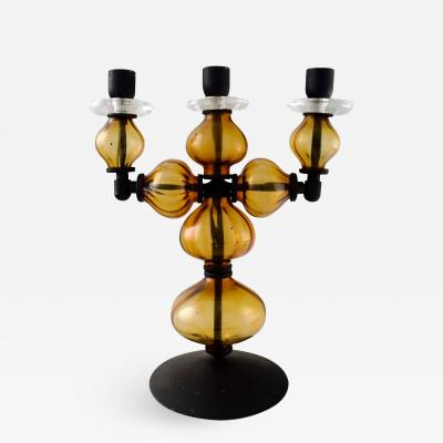 Erik H glund Large three armed candlestick of cast iron with hand blown art glass