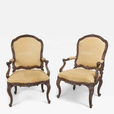 Fine Pair of Carved Walnut Armchairs with Rocaille Ribbons and Flower Motifs