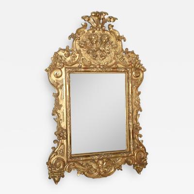 Fine and Monumental Italian Baroque Giltwood Mirror
