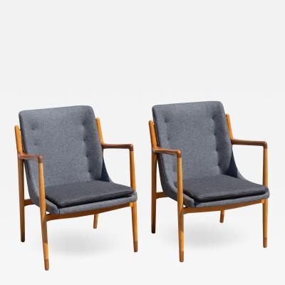 Finn Juhl Pair of Danish Modern Teak and Beech Armchairs in the style of Finn Juhl