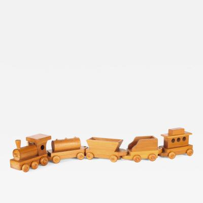 Five piece wooden train set attributed to Montgomery Schoolhouse Vermont