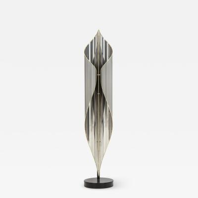 Floor lamp in chrome and steel combined with Brass details