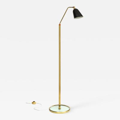 Fontana Arte Tall standing lamp with single black tole shade and glass base