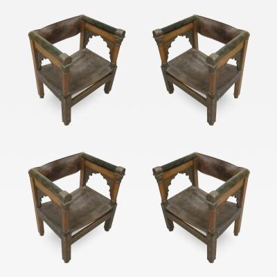 Four Franco Islamic Carved Wood and Leather Lounge Chairs