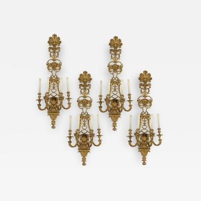 Four large Louis XV style gilt bronze sconces