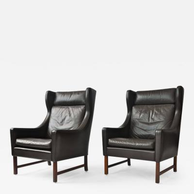 Frederik A Kayser Pair of Frederik Kayser Leather Wing Chairs