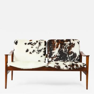 Fredrik Kayser A Fredrik A Kayser Teakwood and Cowhide Settee or Loveseat