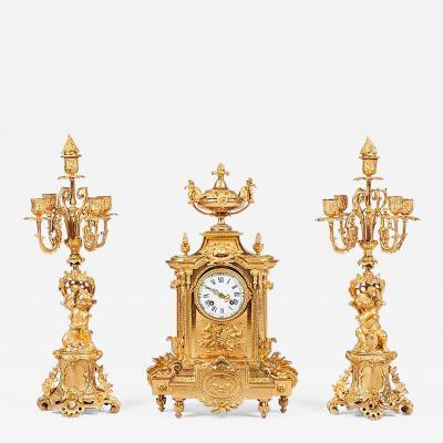 French 19th Century Gilt Bronze Mantel Clock and Candelabra
