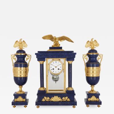 French Empire style lapis and gilt bronze three piece clock set