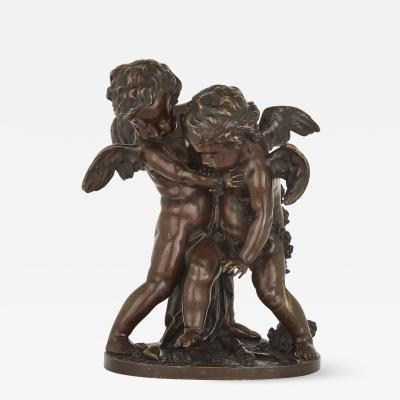 French bronze sculptural group of putti wrestling for a human heart