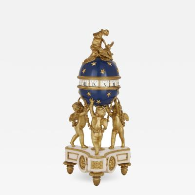French ormolu marble and tole clock with turning dial