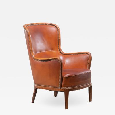 Frits Henningsen Frits Henningsen magoany and leather wingback easy chair