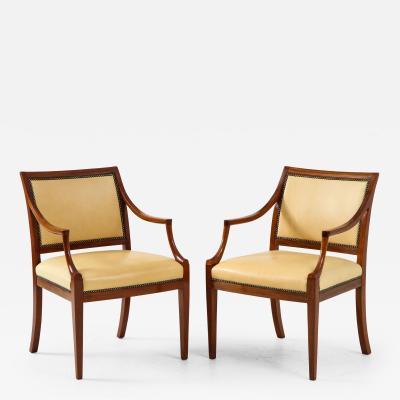 Frits Henningsen Pair of Frits Henningsen Mahogany and Leather Open Armchair circa 1940s