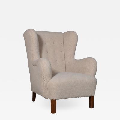 Fritz Hansen Fritz Hansen High backed armchair