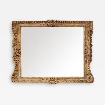 George II period giltwood overmantel mirror manner of Kent