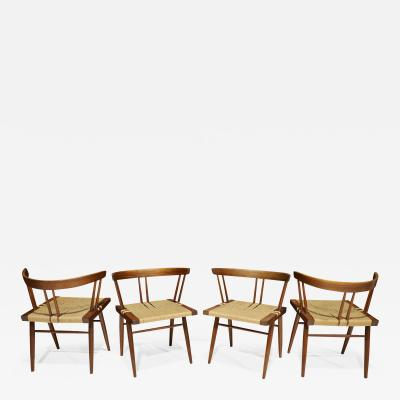 George Nakashima Set of Four Walnut Grass Seat Dining Chairs by George Nakashima US 1961
