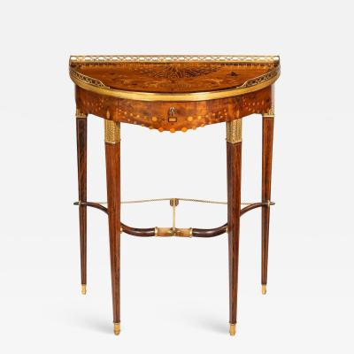 Georges Fran ois Alix A French demi lune rosewood bow and arrow table by Georges Fran ois Alix