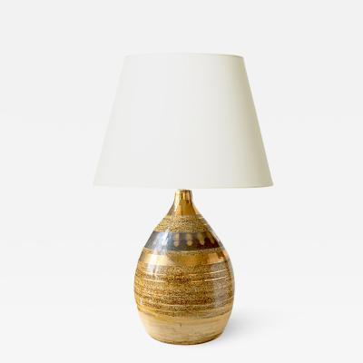Georges Pelletier Table lamp with sandy glazing and gilded stripes by Georges Pelletier