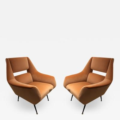 Gigi Radice A pair of Gigi Radice upholstered club chairs on iron legs