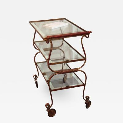 Gilbert Poillerat Gilt iron trolley with three tops