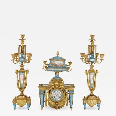 Gilt bronze and S vres style porcelain clock garniture