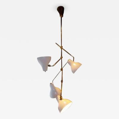 Gino Sarfatti A Four Light Brass and Enameled Chandelier by Gino Sarfatti