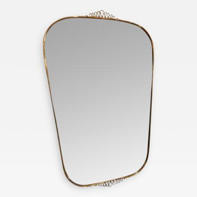Gio Ponti A Gilt Brass Framed Wall Mirror in the style of Gio Ponti
