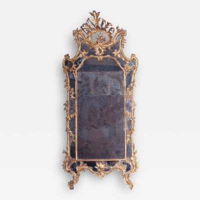 Giovan Battista Dolci A Carved and Gilded Rococo Mirror with Antique Mirror Glass