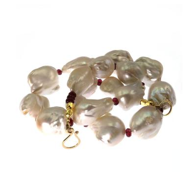 Glowing White Baroque Pearls accented with faceted Rhodolite Garnets Necklace
