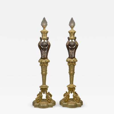 Goelzer and Poumaroux A Pair of Napol on III Figural Torcheres