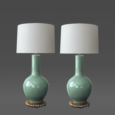 Good quality pair of Chinese bottle form celadon lamps on gilt wood bases