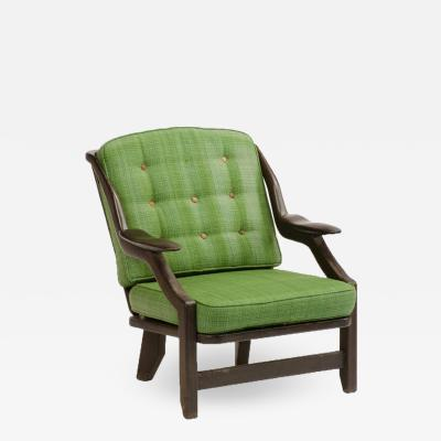Guillerme et Chambron A French Guillerme et Chambron black oak armchair circa 1970