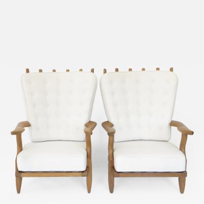 Guillerme et Chambron PAIR OF GRAND REPOS FRENCH OAK LOUNGE CHAIRS BY GUILLERME ET CHAMBRON