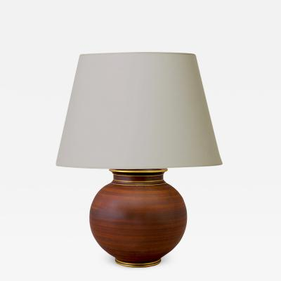 Gunnar Nylund Table lamp with faux bois finish and gilt details by Gunnar Nylund