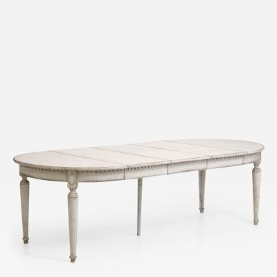 Gustavian style extension table with three leaves with apron