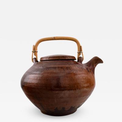 Gutte Eriksen Gutte Eriksen own workshop tea pot in ceramics Handle in wicker