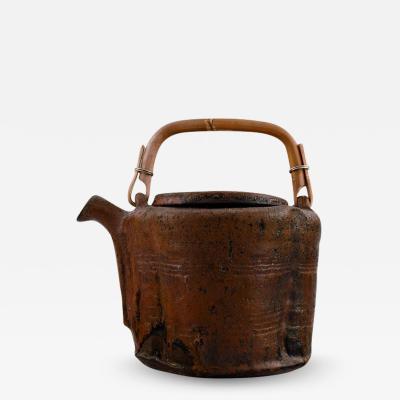 Gutte Eriksen Unique teapot of stoneware with handle in wicker Raku technique