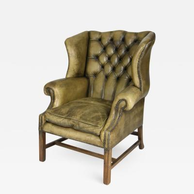 Handsome Mahogany and Original Tufted Green Leather Wing Chair