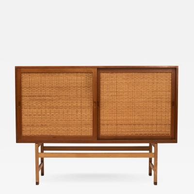 Hans Wegner HANS J WEGNER TALL SIDEBOARD IN OAK W DOORS OF CANE