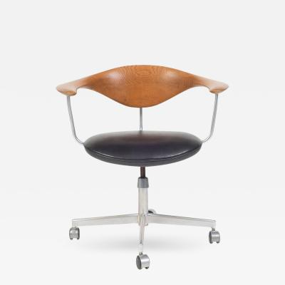 Hans Wegner Hans J Wegner Oak Swivel Chair with Black Leather Seat Denmark 1955