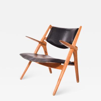 Hans Wegner Hans Wegner Model CH28 Sawbuck Lounge Chair by Carl Hansen