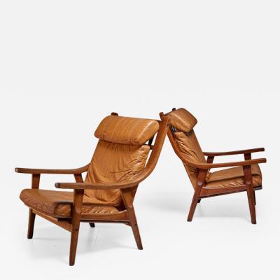 Hans Wegner Hans Wegner pair of lounge chairs Denmark 1970s