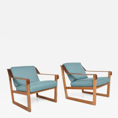 Hans Wegner Pair of Danish Modern Arm Chairs in Oak and Rosewood Arms