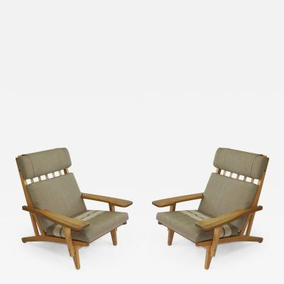 Hans Wegner Pair of Wide Arm Lounge Chairs by Hans Wegner
