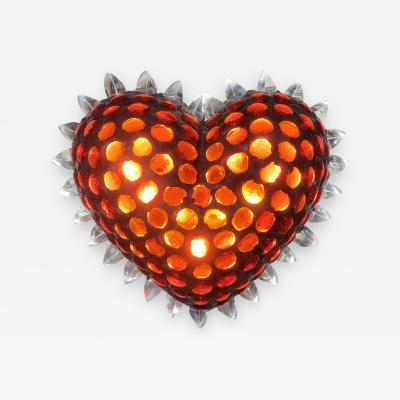 Heart shaped sculptural wall light