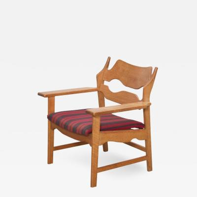 Henning Kjaernulf Oak Razor Back Lounge Chair by Henning Kjaernulf