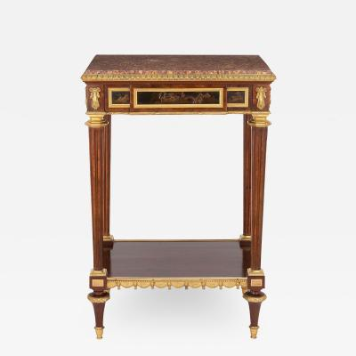 Henry Dasson Ormolu mounted mahogany occasional table by Henry Dasson